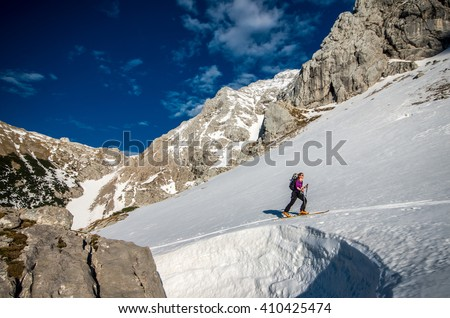 Girl ski touring in mountains
