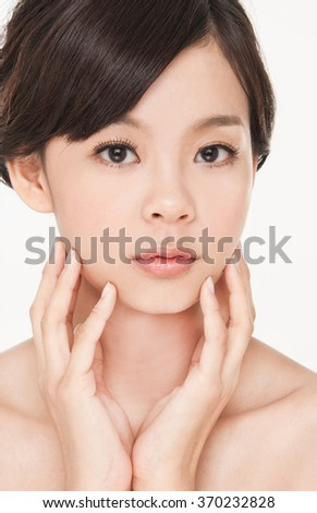 girl Skin care smile face close up and her touch health face - stock photo