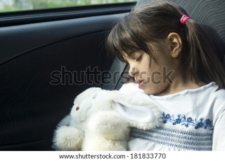 Girl sleeping in car - stock photo