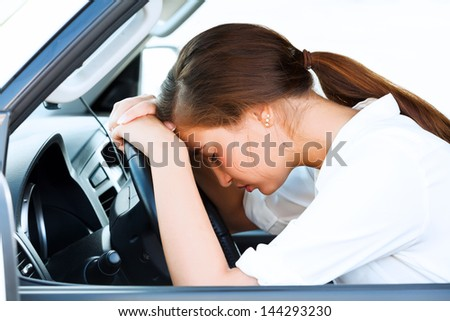 Girl sleeps in a car - stock photo