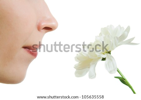 Girl smelling a flower on a white background. - stock photo