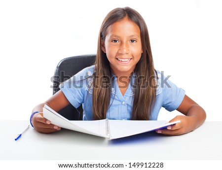 Girl smiling while doing her homework on a white background