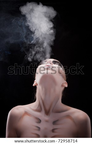girl smokes with body painting for Halloween - stock photo