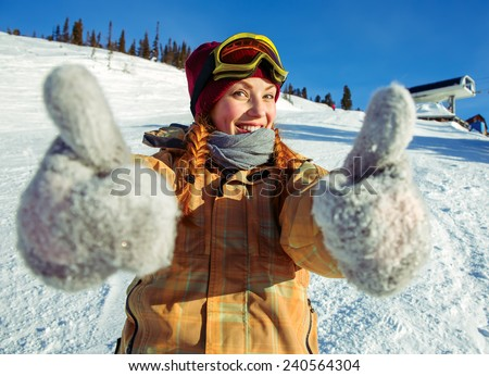 Girl snowboarder in a good mood - stock photo
