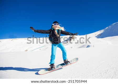 girl snowboarding in the mountains