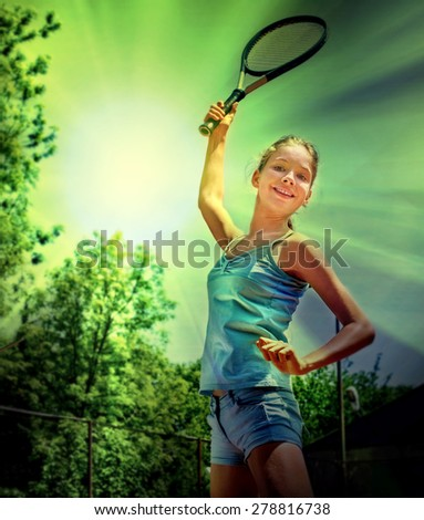 Girl sportsman with racket and ball in the sun and green trees. Toned image. - stock photo