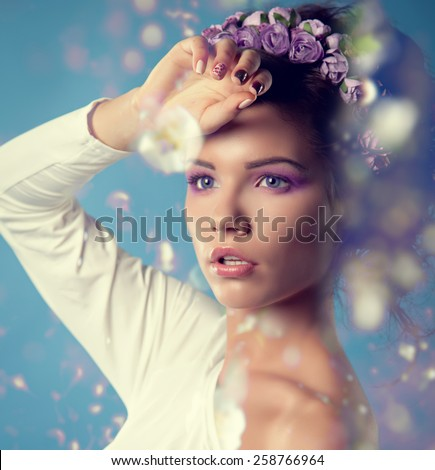 girl spring. Goddess of spring in a wreath of flowers. - stock photo