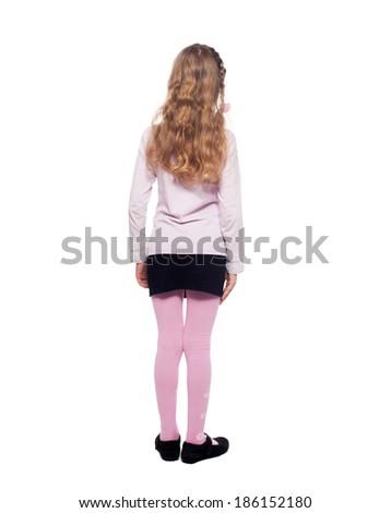 Girl standing back. Girl isolated on white. School child elementary - stock photo