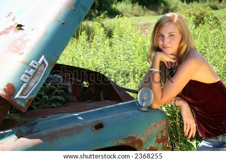 girl standing by old pick up truck