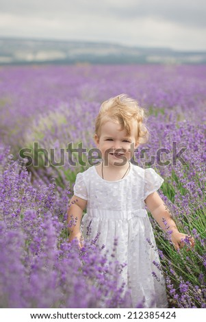 girl standing in a field of lavender - stock photo