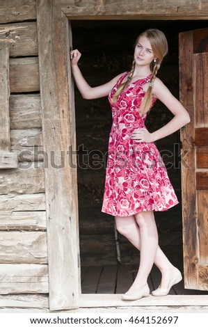 Girl standing in the doorway of an old village house