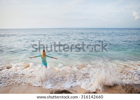 girl standing in the waves