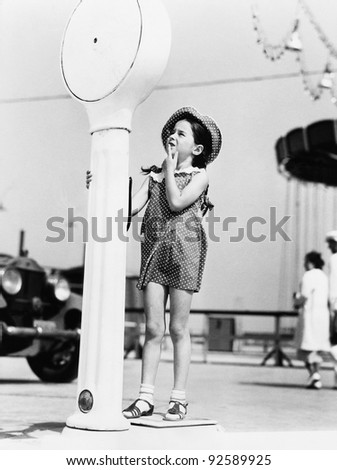 Girl standing on a weighing scale
