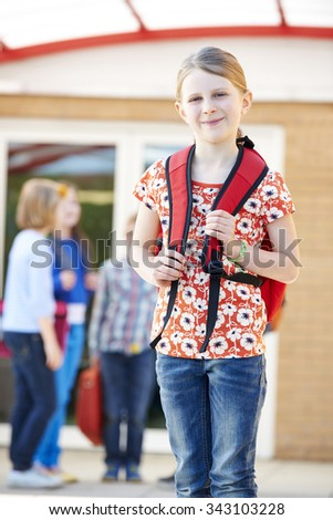 Girl Standing Outside School With Rucksack - stock photo