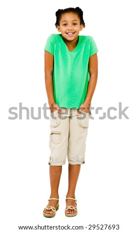 Girl standing with her hands in her pockets isolated over white