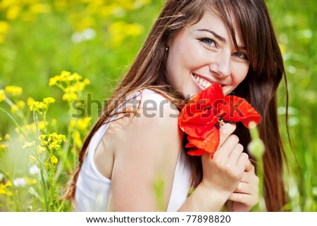 Girl stands in a field of flowers - stock photo