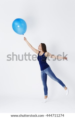 Girl starts to float away with blue balloon