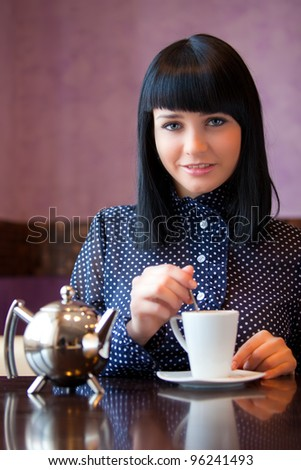 girl stir something in cup