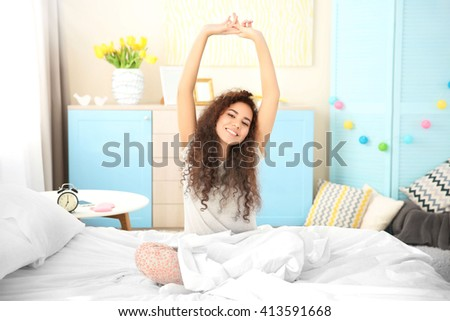 Girl stretching after wake up - stock photo