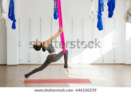 girl stretching legs with help of hammock  aerial exercise or antigravity yoga indoors woman girl stretching legs help hammock aerial stock photo 646160239      rh   shutterstock