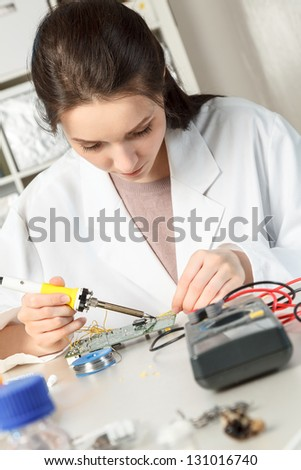 Girl student in the laboratory of electronics university - stock photo