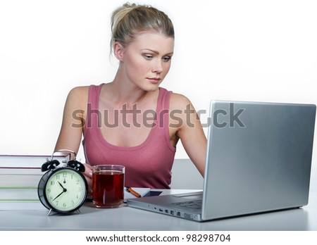 Girl student. Sits at a desktop with the computer. - stock photo