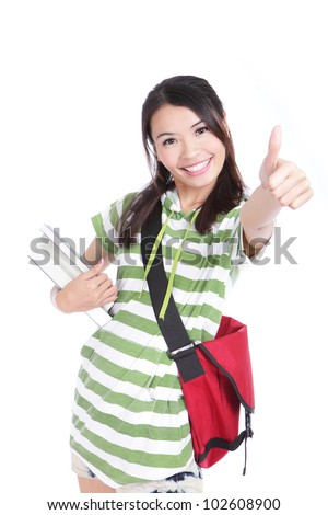 girl student thumbs up hand gesture with great smile isolated on white background, model is a asian woman - stock photo