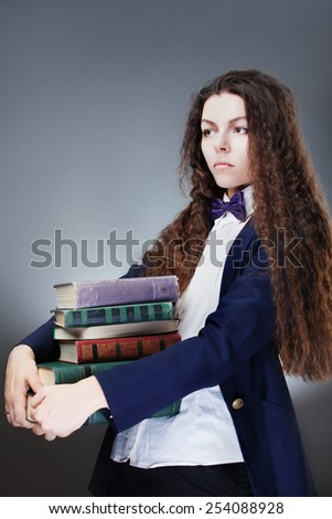 Girl student with books - stock photo