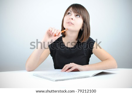 Girl student writes the exercise of the examinations - stock photo
