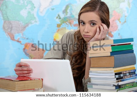 girl studying at her desk - stock photo