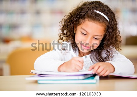 Girl studying at school looking very happy