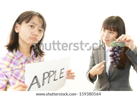 Girl studying in English with teacher  - stock photo