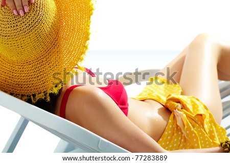 Girl sunbathing in chaise lounge - stock photo