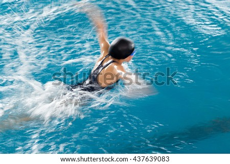Girl swimming in the pool