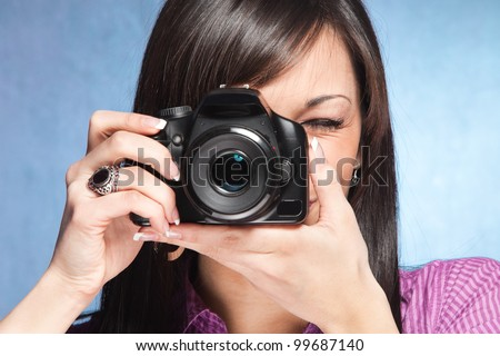 girl take a photo with digital camera - stock photo