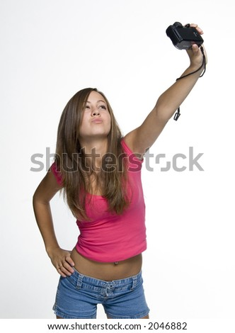 girl taking a picture of herself - stock photo