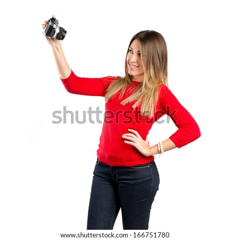 Girl taking a picture over white background  - stock photo