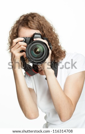 Girl taking a picture using digital camera - stock photo