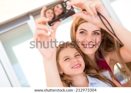 Girl taking a selfie with her mother or sister