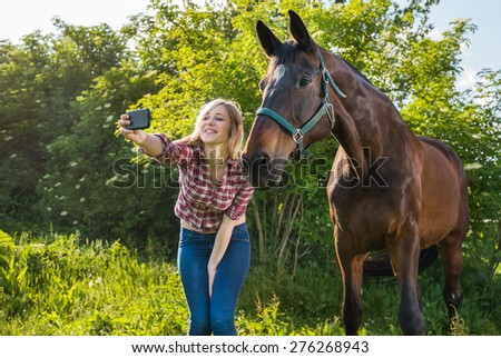 girl taking a selfie with his horse