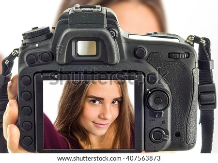 Girl taking selfie from professional camera