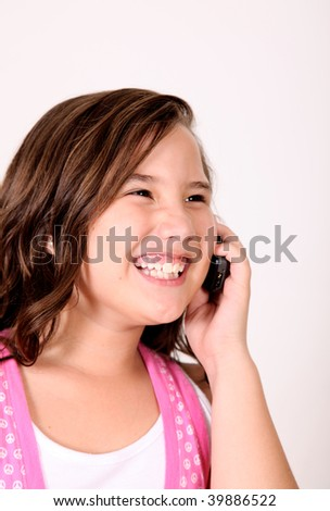Girl talking on her mobile phone and smiling. - stock photo