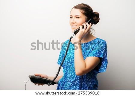 girl talking on the landline - stock photo