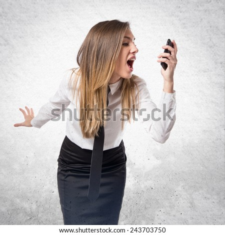 Girl talking to mobile over textured background.  - stock photo