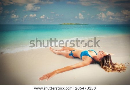 Girl tan lying seashore on the sand
