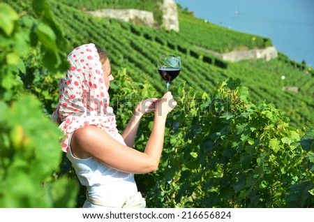 Girl tasting red wine in Lavaux, Switzerland - stock photo