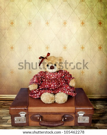 Girl Teddy Bear on a Suitcase  for your Card - stock photo
