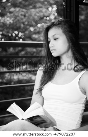 Girl teenager sitting with a book