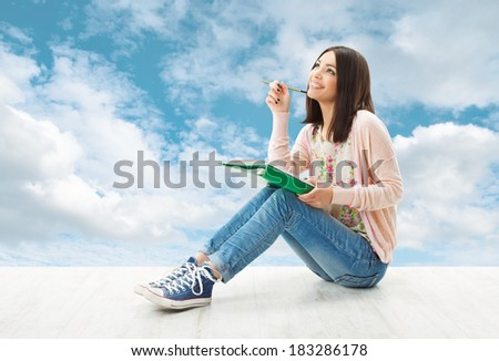 Girl teenager thinking inspiration or write idea, sitting over blue sky background  - stock photo