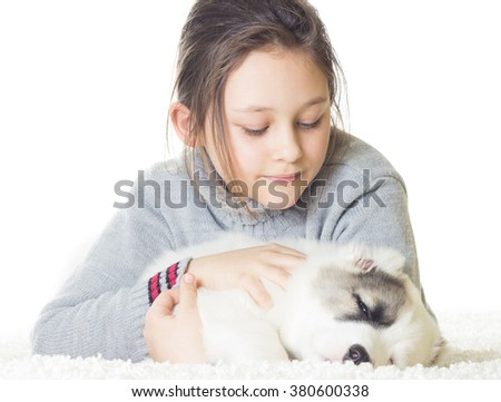 girl tenderly embraces a puppy - stock photo
